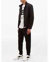 Baskets basses en cuir et néoprène Aurelien Christian Louboutin pour homme en coloris White
