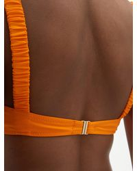 Haut de bikini bandeau Colombier Fisch en coloris Orange