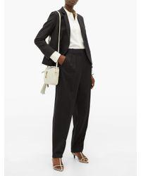 Nili Lotan Black Linda Pinstriped Wool-blend Tapered Trousers