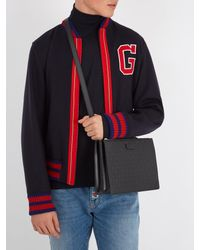 Gucci - Black Gg-debossed Leather Cross-body Bag for Men - Lyst