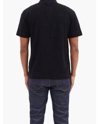 Polo en coton éponge Sunspel pour homme en coloris Black