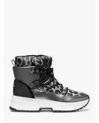 Michael Kors Black Stiefel Cassia aus Nylon mit Gepardenmuster und spiegelnden Metallic-Einsätzen