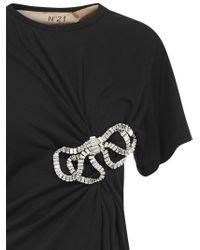 T-shirt nera in cotone con aggrappatura chiusa dal fiocco di cristalli rettangolari. di N°21 in Black