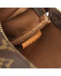 Monogram Pochette Accessoires Canvas di Louis Vuitton in Brown