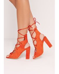 f10b8288bd3b Lyst - Missguided Curved Edge Lace Up Block Heels Sandal Orange in ...