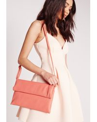 Missguided - Orange Fold Over Clutch Bag Pink - Lyst
