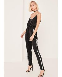 ce8a333184c Missguided Black Satin Sports Striped Strap Jumpsuit in Black - Lyst