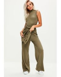 ee82b918df Lyst - Missguided Khaki High Neck Tie Front Jumpsuit in Natural