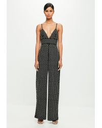 556e00bcc5a Missguided Peace + Love Black Strappy Hotfix Flared Jumpsuit in ...