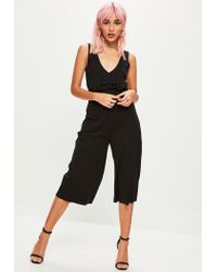 Missguided - Black Ribbed Sleeveless Jumpsuit - Lyst