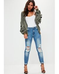 Missguided - Riot High Rise Ripped Knee Slim Leg Jeans Stonewash Blue - Lyst