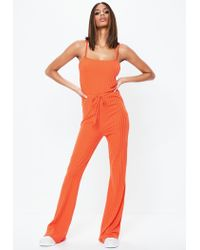 Missguided - Orange Drawstring Waist Flare Leg Jumpsuit - Lyst