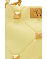 Valentino Garavani Yellow Garavani Roman Stud Small Leather Top Handle Bag