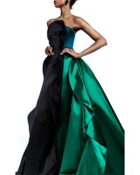 Elizabeth Kennedy Blue Strapless Gown With Ruffles And Train