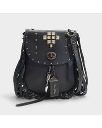 COACH Pyramid Rivets Fringe Saddle Bag In Black Leather