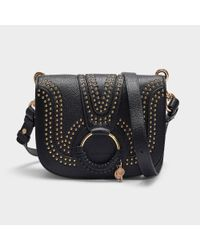 757ffe30c6 see-by-chloe-Black-Hana-Small-Crossbody-Bag-With-Studs-In -Black-Grained-Leather.jpeg