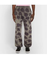 Stussy Black Logo-embroidered Tie-dyed Fleece-back Cotton-jersey Sweatpants for men
