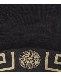 Top sportivo in jersey di Versace in Black
