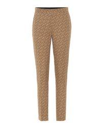 Pantalon imprimé en soie Burberry en coloris Brown
