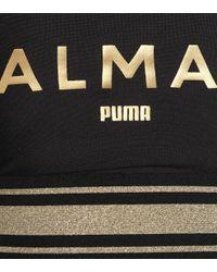 X Balmain – Brassière de sport imprimée PUMA en coloris Black