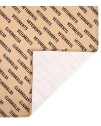 Sciarpa a stampa in pile di Vetements in Natural
