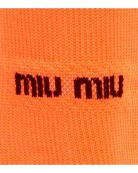 Chaussettes montantes Miu Miu en coloris Orange