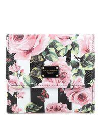 Portefeuille en cuir imprimé Dolce & Gabbana en coloris Pink