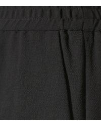 Pantalon large en crêpe Bottega Veneta en coloris Black