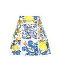Minigonna a stampa in cotone e seta di Dolce & Gabbana in Multicolor