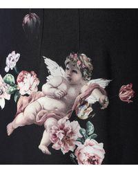Jupe imprimée à taille haute Dolce & Gabbana en coloris Black
