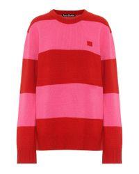 Pullover a righe in lana di Acne in Red