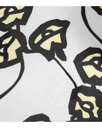 Top a stampa floreale in raso di Marni in Black