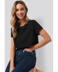 Raw Hem Cropped T-shirt NA-KD en coloris Black