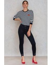 NA-KD Black Trend Ripped Bottom Highwaist Jeans