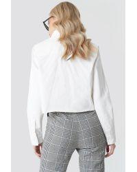 NA-KD White Trend Raw Hem Denim Shirt