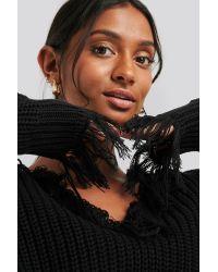 NA-KD Ripped Hem V-neck Sweater in het Black