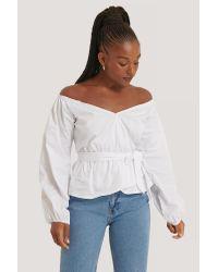 NA-KD White Trend Off Shoulder Tie Waist Blouse