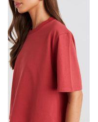 Oversized Short Tee NA-KD en coloris Red