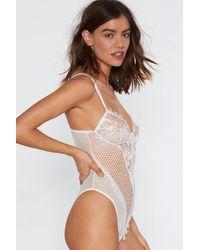 "Nasty Gal White ""rave On Lace Bodysuit"""