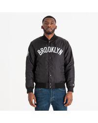 newera Black Brooklyn Nets Wordmark Varsity Jacket for men