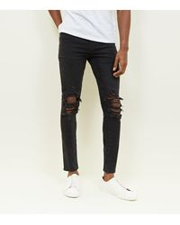 New Look Black Washed Ripped Knee Skinny Jeans for men