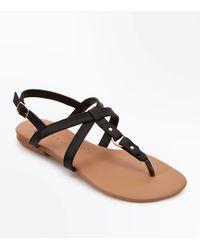 38c7176b1 New Look Teens Black Cross Strap Ring Sandals in Black - Lyst