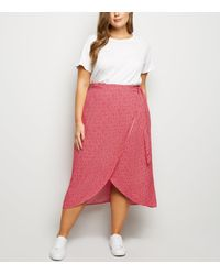 New Look Curves Pink Floral Wrap Front Midi Skirt