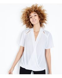 New Look Off White Cut Out Wrap Hem Blouse