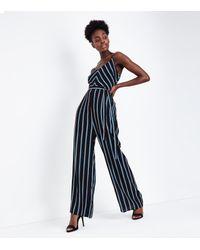 bcb5016a79f9 New Look Blue Chevron Stripe Strappy Jumpsuit in Blue - Lyst