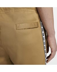Pantaloni Sportswear di Nike in Natural da Uomo