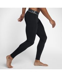 4fb9aa29de43c Nike Pro Warm Men's Training Tights in Black for Men - Lyst