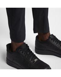 Pantaloni Sportswear Tech Pack di Nike in Black da Uomo