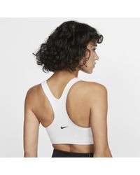 Bra a sostegno medio JDI Rebel Swoosh di Nike in White