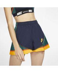Short tempo plissé x Sacai pour Nike en coloris Blue